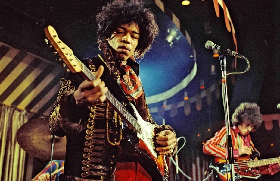 DO NOT DELETE OR  PURGE FROM MERLIN  courtesy Everett Collection Mandatory Credit: Photo By MARC SHARRAT / Rex Features, courtesy Everett Collection THE JIMI HENDRIX EXPERIENCE VARIOUS - 1967  PERFORMING MARQUEE CLUB, LONDON   - 02 MAR 1967 16987j He is playing a The 1965 Fender Stratocaster sunburst red/yellow  without a whammy - bar and no sustainable pedals.   this guitar  was set on fire in LONDON in a concert at Finsbury Astoria in north London on March 31st, 1967 . This photo was taken 29 days before he smashed this guitar. | Copyright © Rex Features/ Everett Collection / Everett Collectio